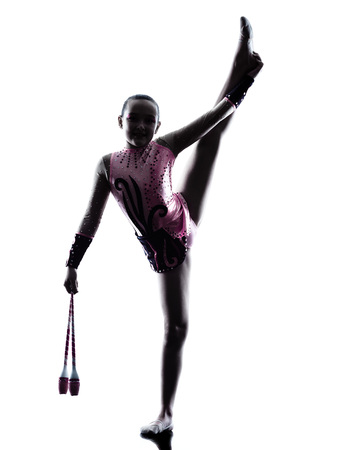 children sport: one caucasian little girl child  exercising Rhythmic Gymnastics in silhouette isolated on white background
