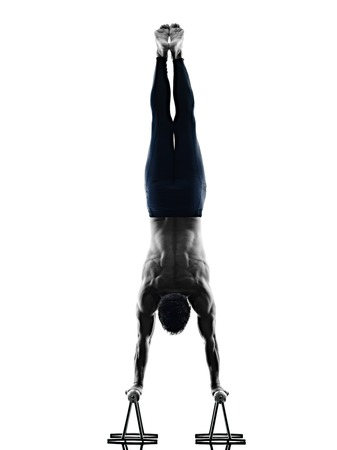 one caucasian man exercising pilates exercises fitness in silhouette isolated on white backgound Stock Photo