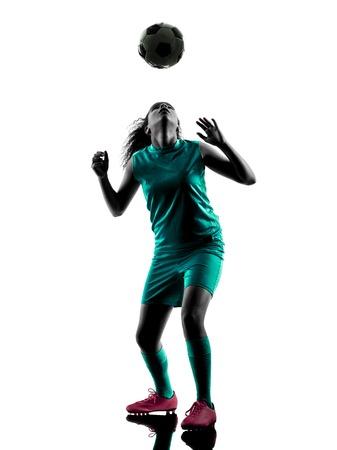 siluetas mujeres: un adolescente jugador de f�tbol juego Chica ni�o en la silueta aislado en el fondo blanco