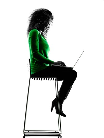 mixed race woman: one mixed race young woman using laptop Computers silhouette isolated on white background