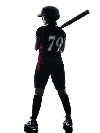 iluminado a contraluz: una mujer jugadores de softbol de juego en silueta aislados sobre fondo blanco Foto de archivo