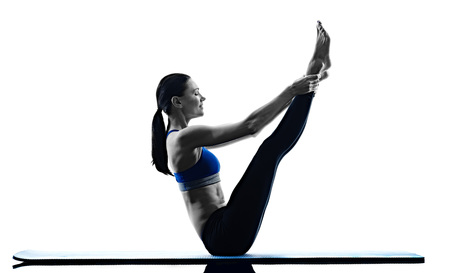 situps: one caucasian woman exercising pilates exercises fitness in silhouette isolated on white backgound