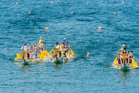 china people: Hong Kong, China- June 2 , 2014: People racing the Dragon boats festival race in Stanley beach