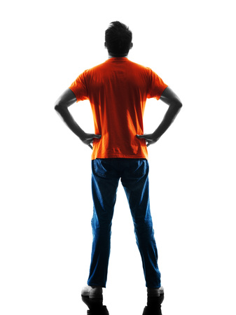 causcasian: one causcasian man standing Rear View in silhouette isolated on white background Stock Photo