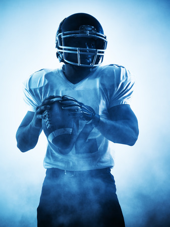 people in action: one american football player portrait in silhouette shadow on white background