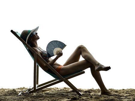 deck chair: woman on the beach sea sunbathing holidays vacations silhouette isolated on white background Stock Photo