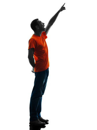 one causcasian man standing Pointing in silhouette isolated on white background