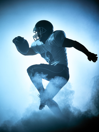 shadow silhouette: one american football player portrait in silhouette shadow on white background