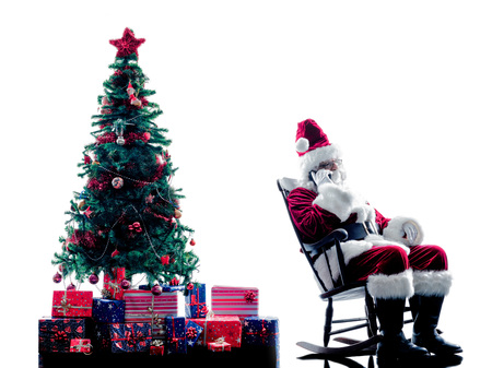 telephones: one santa claus man using Telephones silhouette isolated on white background