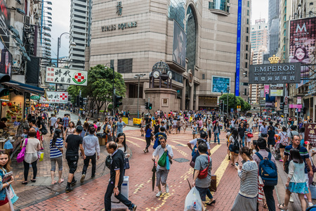 china people: Causeway Bay, Hong Kong, China- June 7, 2014: people walking in the street outside Times Square