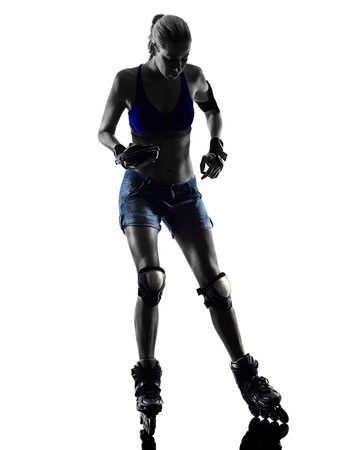 skaters: one  woman in roller skates silhouette studio isolated on white background Stock Photo