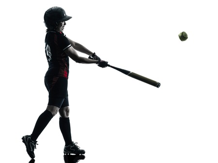 softball player: one woman playing softball players in silhouette isolated on white background