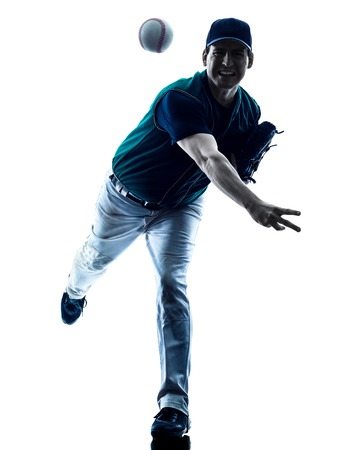 one caucasian man baseball player playing  in studio  silhouette isolated on white background Banco de Imagens