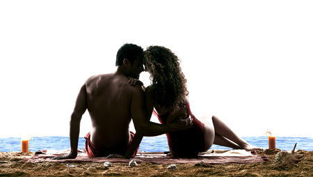 one caucasian couple man and woman lovers kissing on the beach silhouette isolated on white background Stock Photo