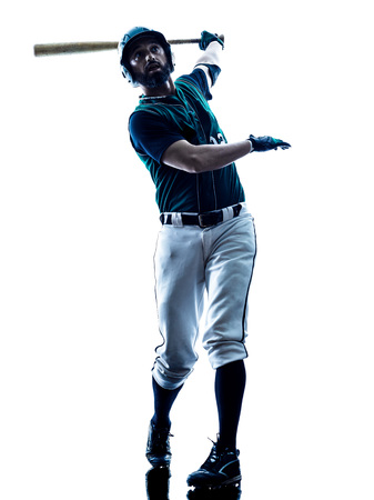 one caucasian man baseball player playing  in studio  silhouette isolated on white background Imagens