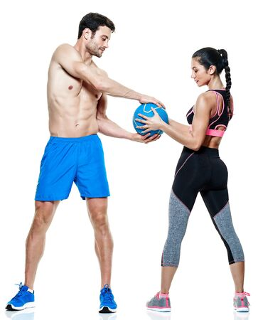 ball isolated: one caucasian couple man and woman exercising fitness exercises isolated on white background Stock Photo