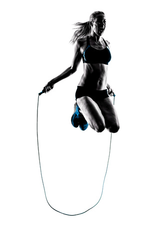 rope background: one caucasian woman Jumping Rope exercises  in studio silhouette isolated on white background