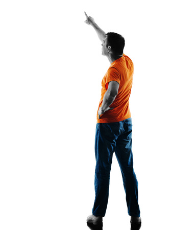 causcasian: one causcasian man standing Rear View Pointing in silhouette isolated on white background Stock Photo