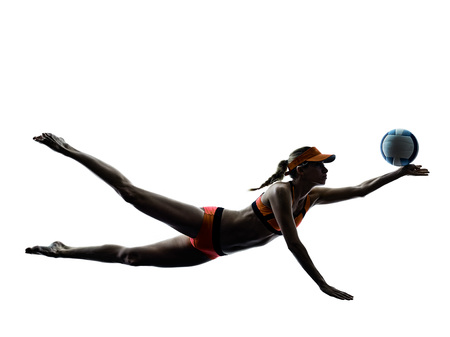 one woman beach volley ball player silhouette in studio silhouette isolated on white background