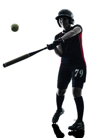 softbol: una mujer jugadores de softbol de juego en silueta aislados sobre fondo blanco Foto de archivo