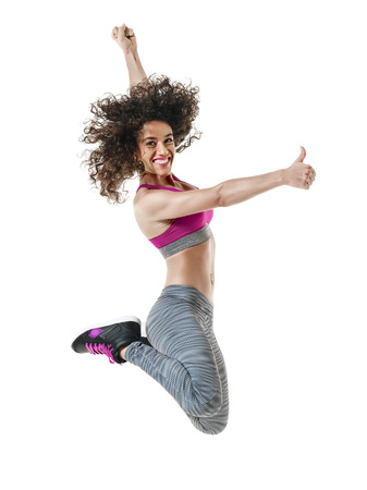 mixed race ethnicity: one mixed race woman  dancer dancing fitness exercises isolated on white background Stock Photo