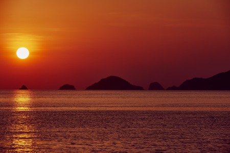 sunsets: seascape  at sunset between El Nido and coron in Palawan Philippines Palawan Philippines