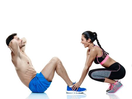 white man: one caucasian couple man and woman exercising fitness exercises isolated on white background Stock Photo