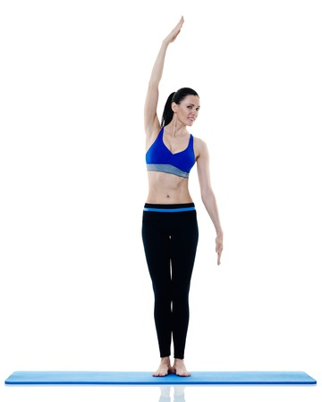 pilates studio: one caucasian woman exercising fitness pilates exercices isolated on white background Stock Photo
