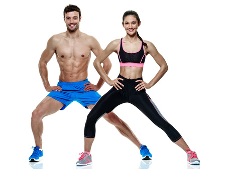 lunges: one caucasian couple man and woman exercising fitness exercises isolated on white background Stock Photo