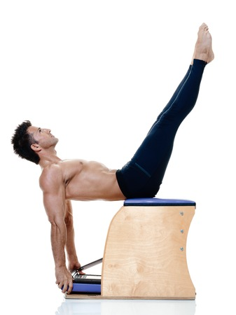 exercices: one caucasian man exercising fitness pilates exercices isolated on white background