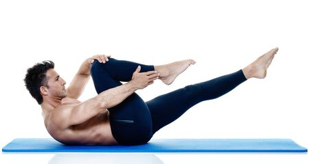 pilates man: one caucasian man exercising fitness pilates exercices isolated on white background