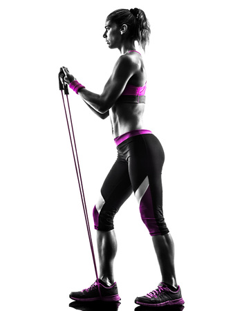 rubber bands: one caucasian woman exercising  fitness resistance bands in studio silhouette isolated on white background Stock Photo