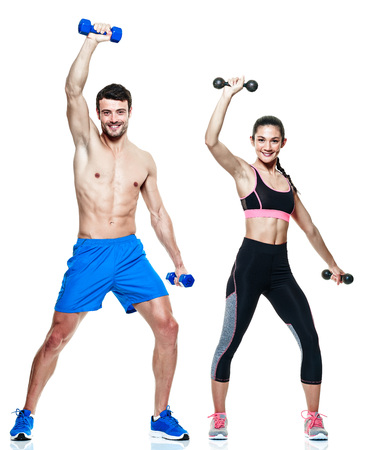 man power: one caucasian couple man and woman exercising fitness exercises isolated on white background Stock Photo