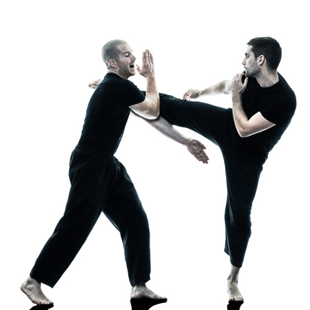 krav maga: two caucasian men krav maga fighters fighting isolated silhouette on white background
