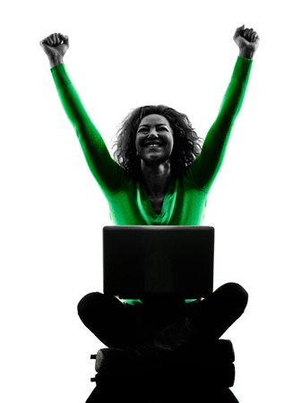 cheer full: one mixed race young woman using laptop Computers silhouette isolated on white background