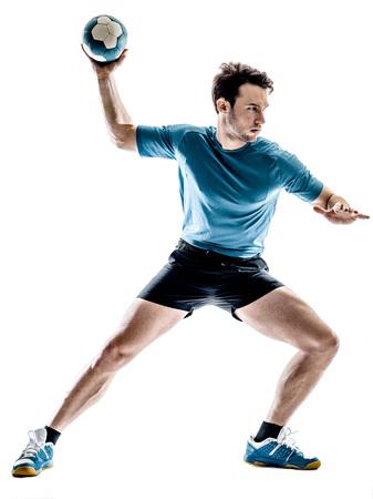 een jonge man handbal speler in de studio op geïsoleerde witte achtergrond Stockfoto