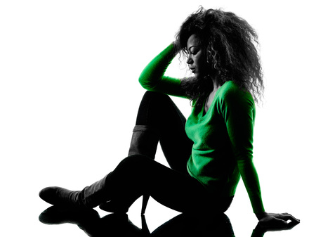 one mixed race young woman sadness despair silhouette isolated on white background Stock Photo
