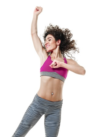 mixed race ethnicity: one mixed race woman zumba dancer dancing fitness exercises isolated on white background