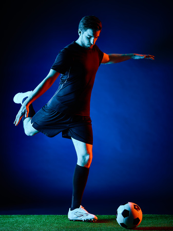 black backgound: one caucasian Soccer player Man isolated on black backgound