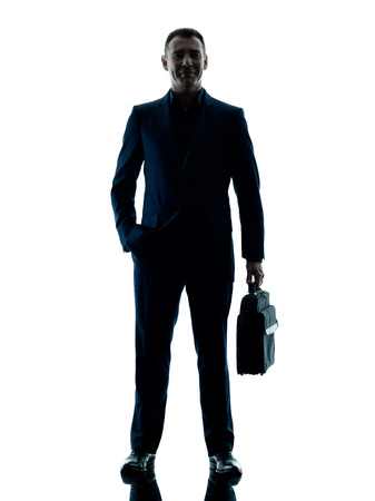 one man: one caucasian business man standing silhouette isolated on white background