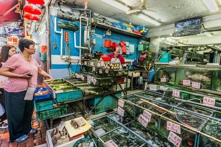 china people: Causeway Bay, Hong Kong, China- June 4, 2014: people shopping at the seafood market Editorial