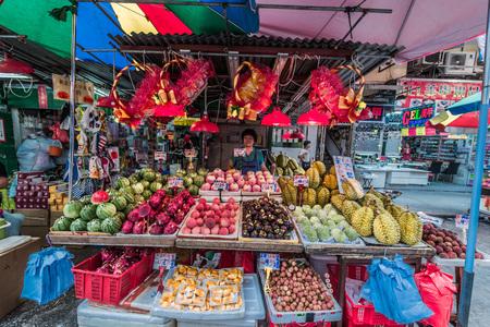 china people: Kowloon, Hong Kong, China- June 9, 2014: people at Mong Kok fruit market