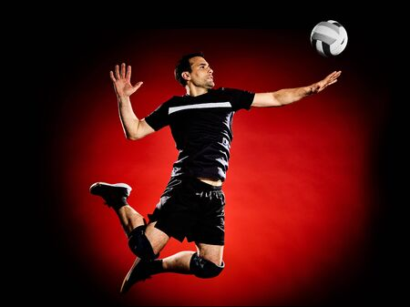 pelota de voley: one caucasian volley ball player man isolated on colorful black background