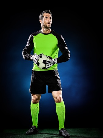 arquero de futbol: one caucasian goalkeeper soccer man isolated on black background