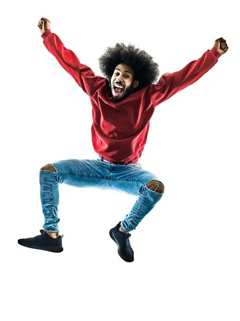 one african man jumping happy in silhouette isolated on white background