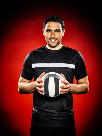 volley ball: one caucasian volley ball player man isolated on colorful black background
