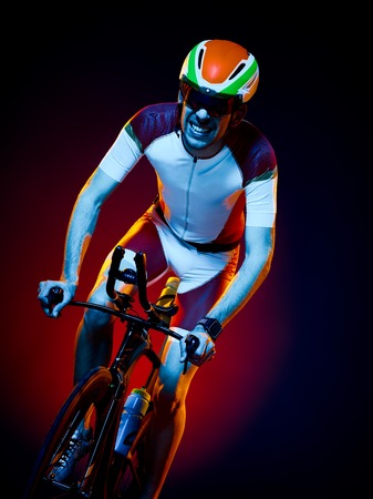 sports race: one caucasian man cyclist cycling bicycle triathlon isolated on black background