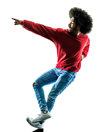 mixed race people: one african man dancer dancing  in silhouette isolated on white background