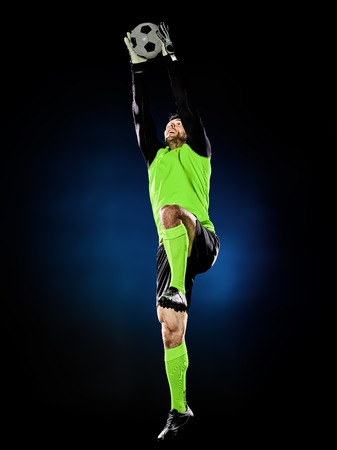 one caucasian goalkeeper soccer man isolated on black background