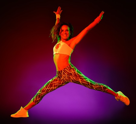 one caucasian woman dancer dancing fitness exercises isolated on colorful background
